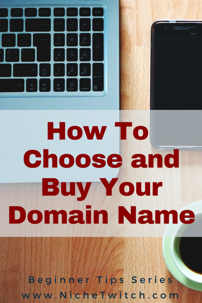 How to Buy a Domain Name (image of laptop, phone, coffee in a workspace)